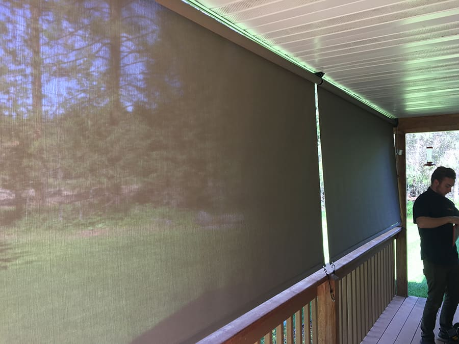 Insolroll Oasis 2600 exterior shades on covered deck in libby MT.JPG