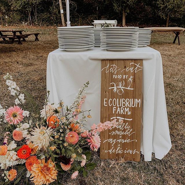 It was a pleasure to create a handful of signs for Stef and Joel's big day! 😍  #Repost @ecolibriumfarms with @get_repost ・・・ Not your average wedding caterer. • • We loved preparing a super special meal for Stef and Joel's wedding a few weeks ago. Chef Kyle incorporated local Orcas Island delicacies with our incredible produce to make a personalized menu of this bride and grooms dreams. Shoutout to the incredible vendor team who shaped this gorgeous day from every angle and our incredible staff who made feeding 100 people without a kitchen a seamless experience! • • Design/Coordination @rockandstoneweddings  with @devinrlarson  Flowers @colibri.blooms  Catering @ecolibriumfarms  Signage @freckledflourishes  Venue @pebblecovefarm  Orcas Vendors: @buckbayshellfishfarm @girlmeetsdirt