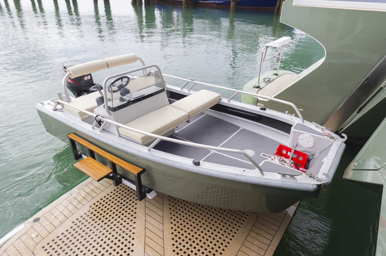 The custom 4.1m tender features a landing craft style ramp at the bow to allow transport of the motor or push bikes