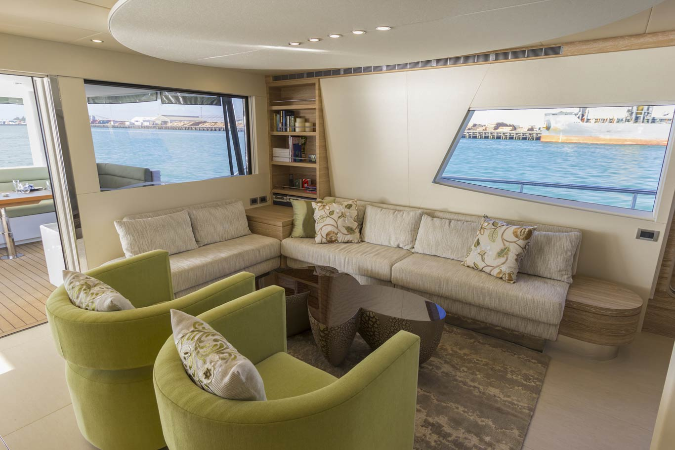 "The port side lounge provides a social space with a view, a 55"" TV drops down from the ceiling for entertainment"