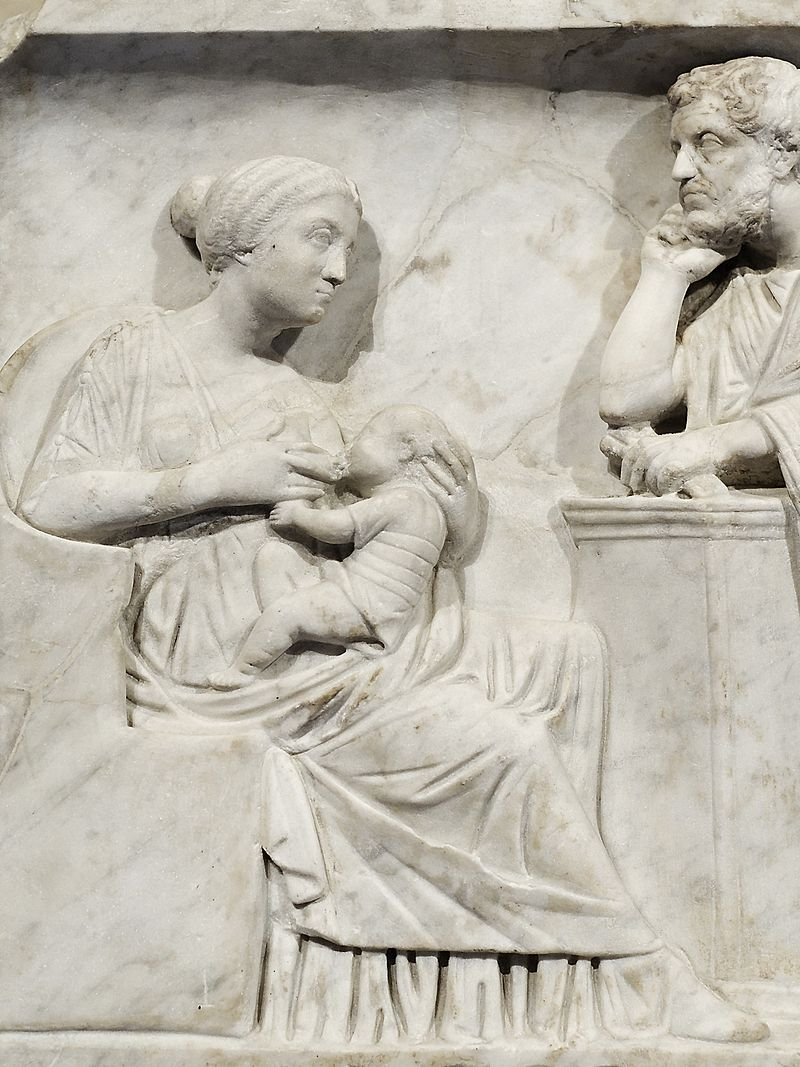 Mother nursing an infant in the presence of the father, detail from a young boy's sarcophagus of Marcus Cornelius Statius, ca. 150 CE (image courtesy of the Louvre)