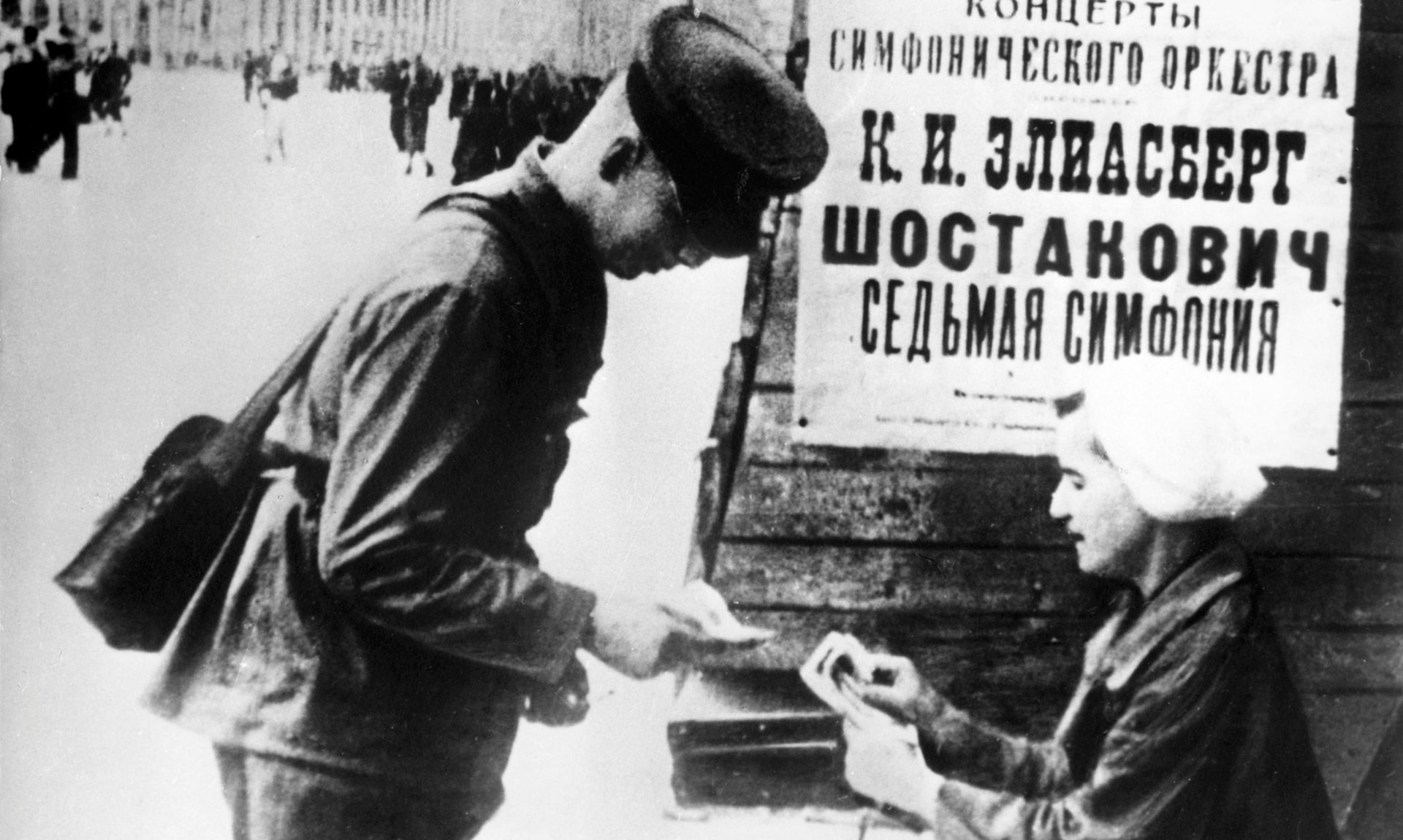 A Soviet soldier buys a ticket to the 1942 performance of Shostakovich's Seventh Symphony in Leningrad. (Photograph Sovfoto/UIG via Getty Images.)