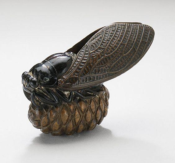 Hokufu, Japan. Cicada on Pine Cone, late 19th century Netsuke, Wood with lacquer staining (image courtesyof Collectionsonline.lacma)