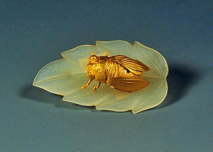 Gold cicada on jade leaf
