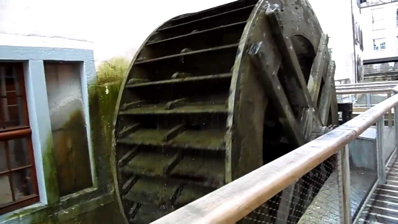 The huge water wheel which powers the paper mill at the Museum