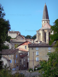 Bell Tower of Saint Jean Baptiste church and houses in medieval town