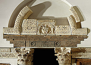 This is a photo courtesy of the Lessing Photo archive of the Louvre's pieces of the North Portal of the Coptic Baouit Chapel. The lintel is carved in acacia, tamarisk and fig wood.