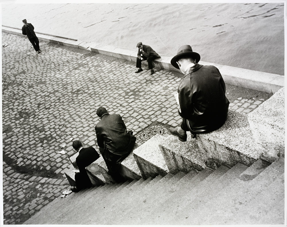 Ilse Bing, 'Three men on steps by the Seine' , (Image courtesy of the Victoria and Albert Museum)
