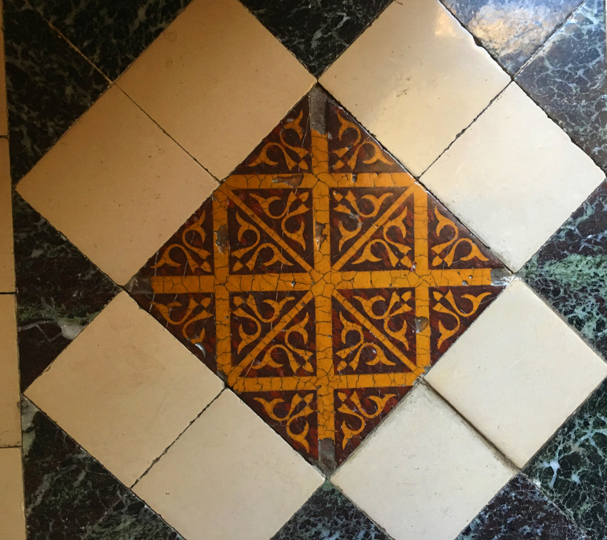 Early clay tiles set in marble tiles at Ancy le Franc (photograph J. Cook)