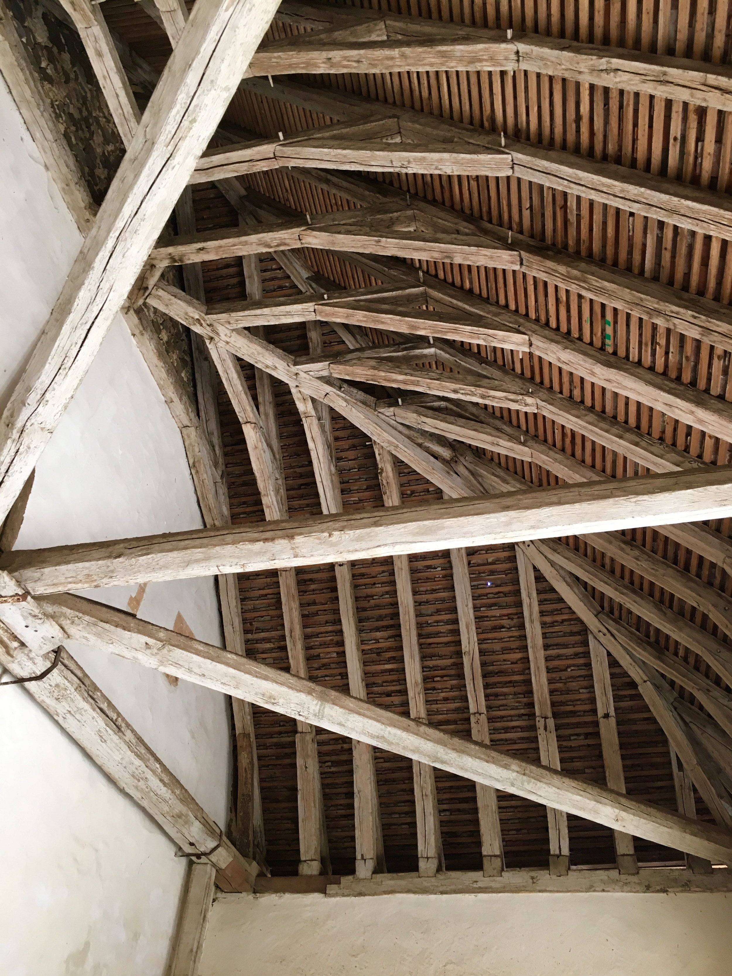 The beautiful beamed roof of the entrance portico, prelude to entering Eglise St. Pierre (photograph J Cook)