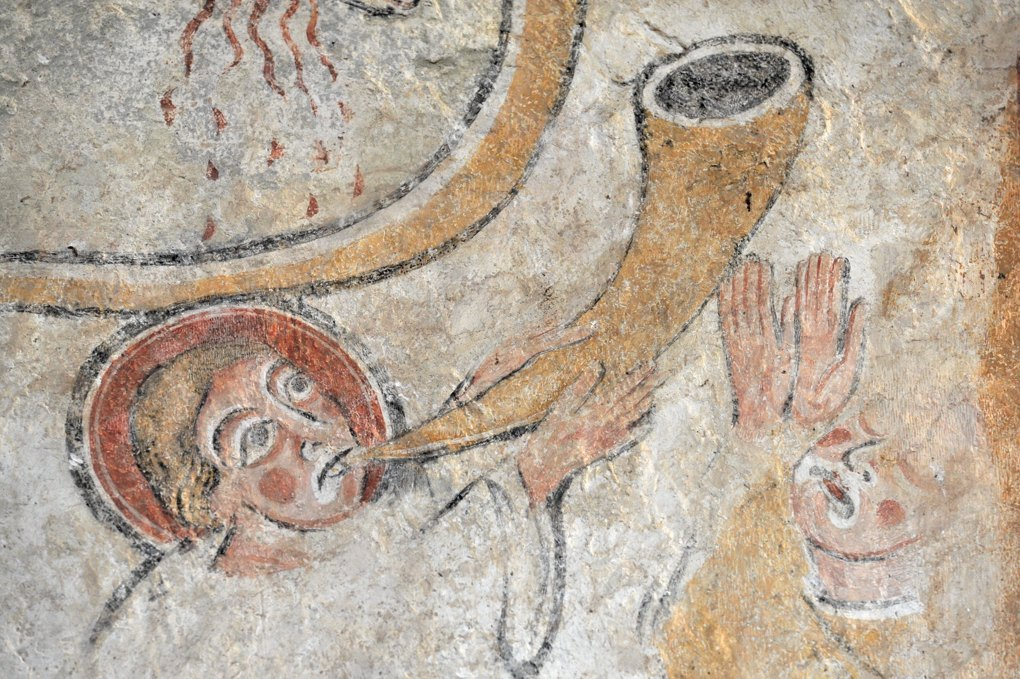 Detail of a 12th century fresco, with the Angel sounding the Trumpet