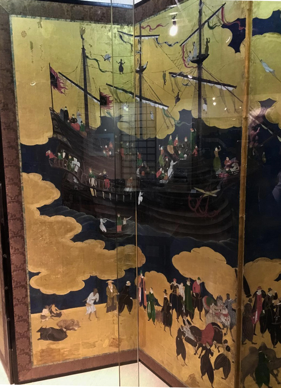 Detail of Portuguese ship. Namban screen. Stamp of Kano Naizen, Japan, 1593-1602, Monoyama Period, tempera on paper, gold leaf, silk, lacquer, metal. Museu de Arte Antiga, Lisbon. ((Photograph J. Cook)