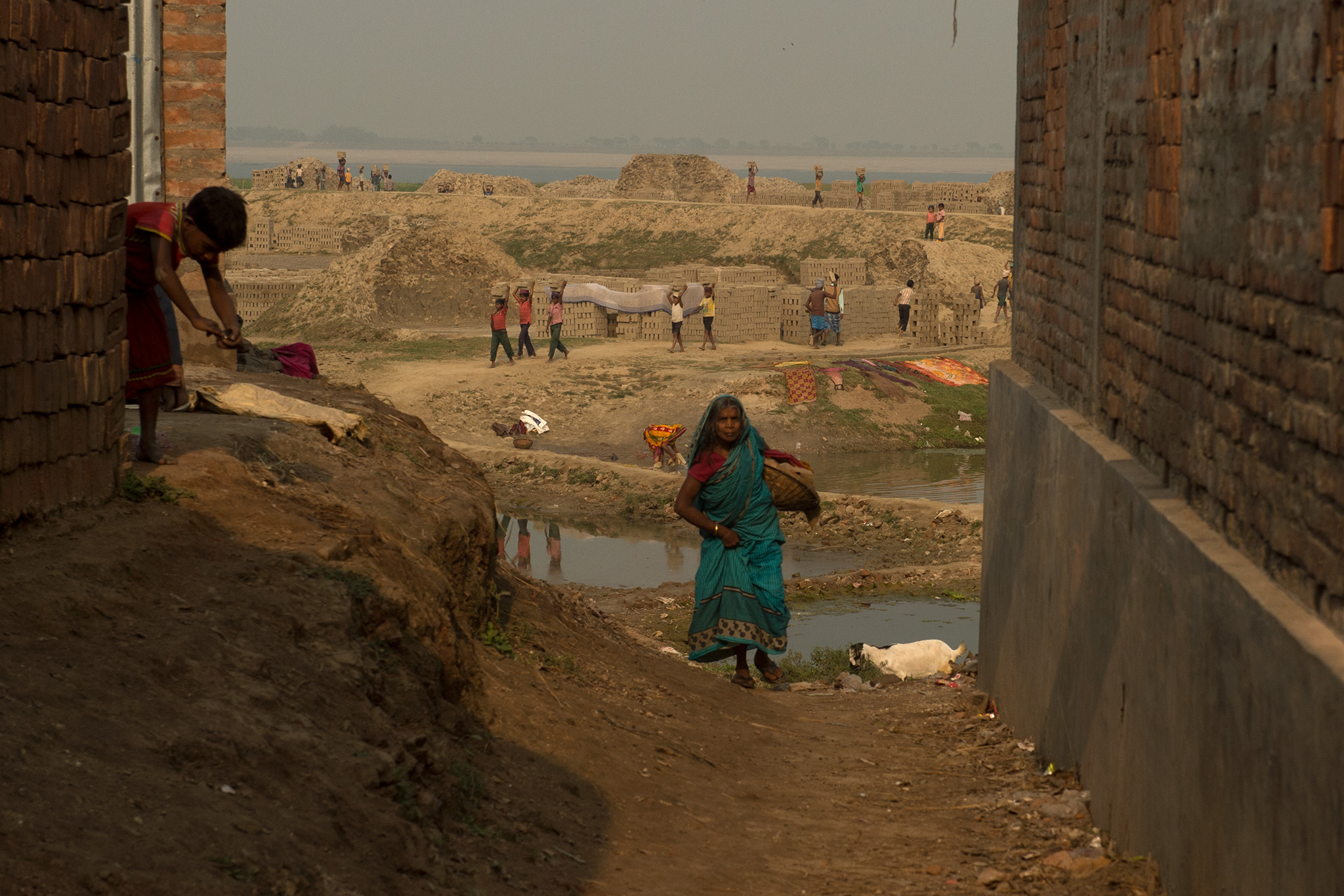 "The next generation of environmental refugees working in a brick kiln. There are many things wrong about this picture. For one, these are all kids -- some not even 6, as far as the eye can see. Another, this brick kiln uses the mud from the banks. It is hollowing out an already weak bank, inviting the river to erode even deeper. Third, this is one of the districts worst affected by erosion, downstream of the Farakka Barrage and ranks 6th highest in population of children in India. It is listed as one of the ""Most Backward Districts"" in India and gets no support from the government"