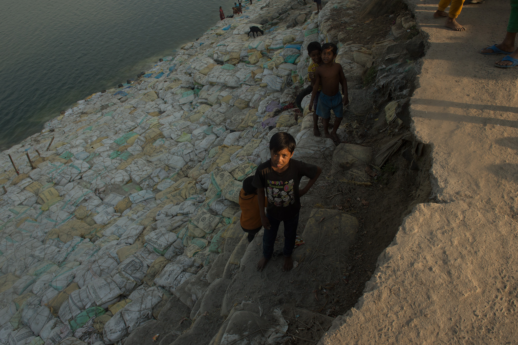 A half-eaten road runs along what has now become a cliff along the Ganga