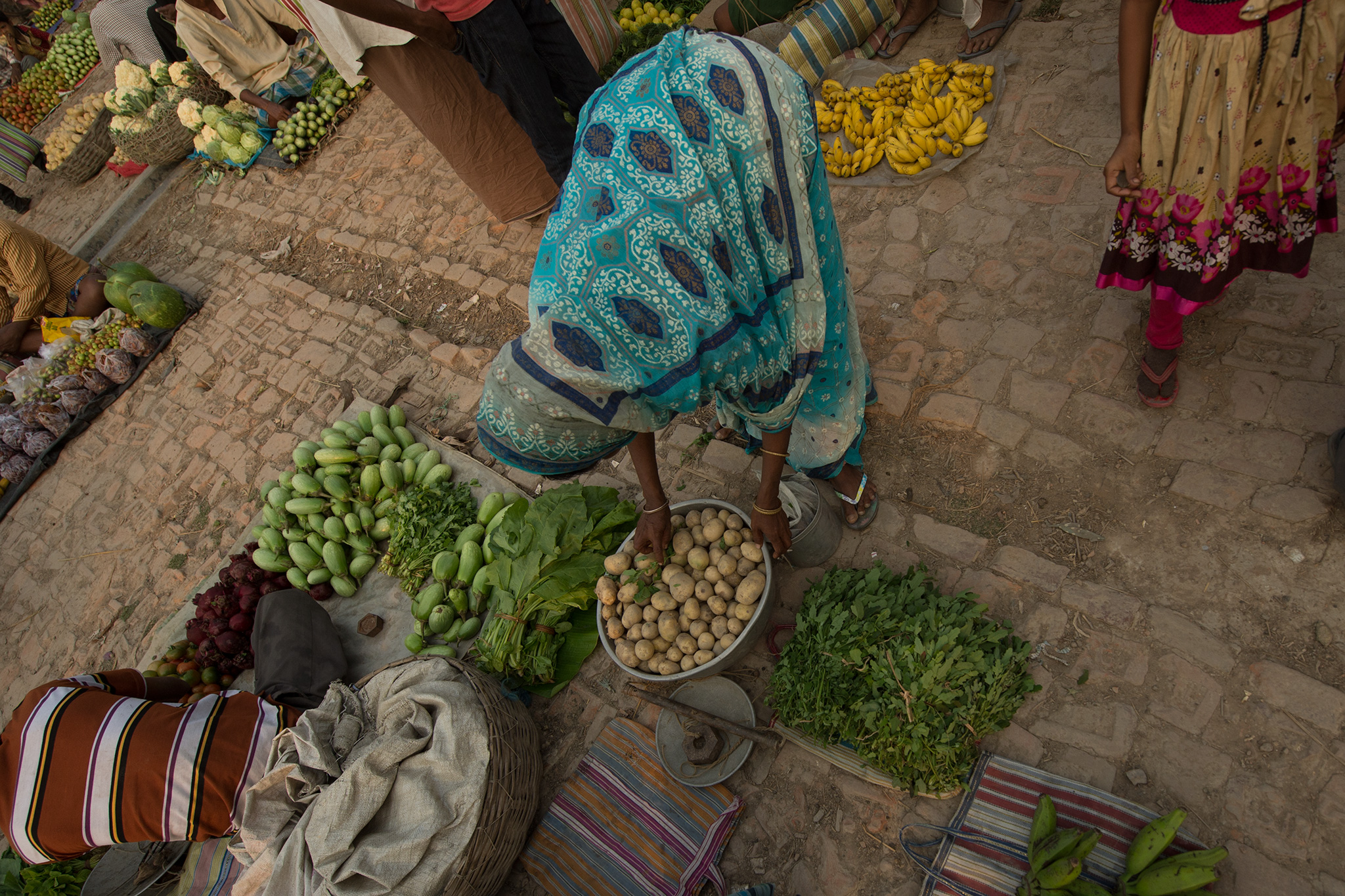 Setting up vegetable shop in the weekly market
