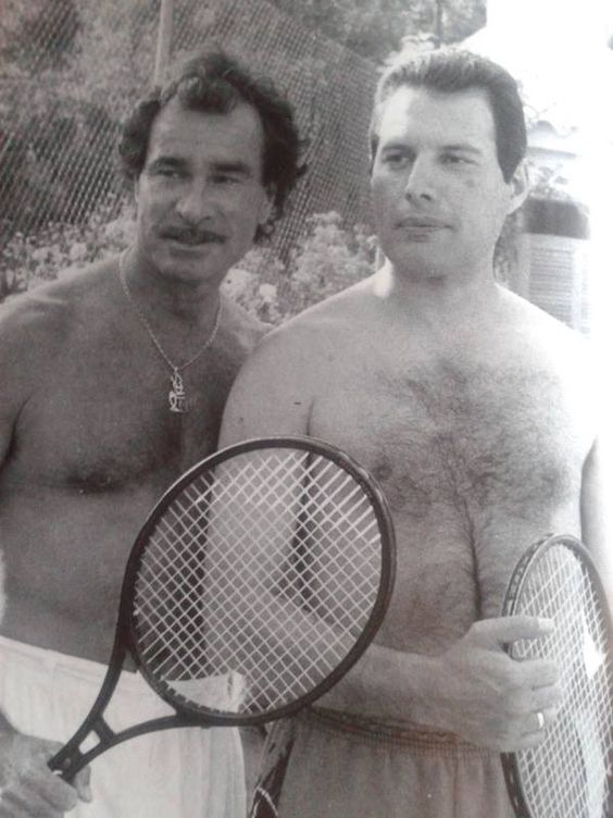 Tony Pike and Freddie Mercury on the tennis court at Pikes