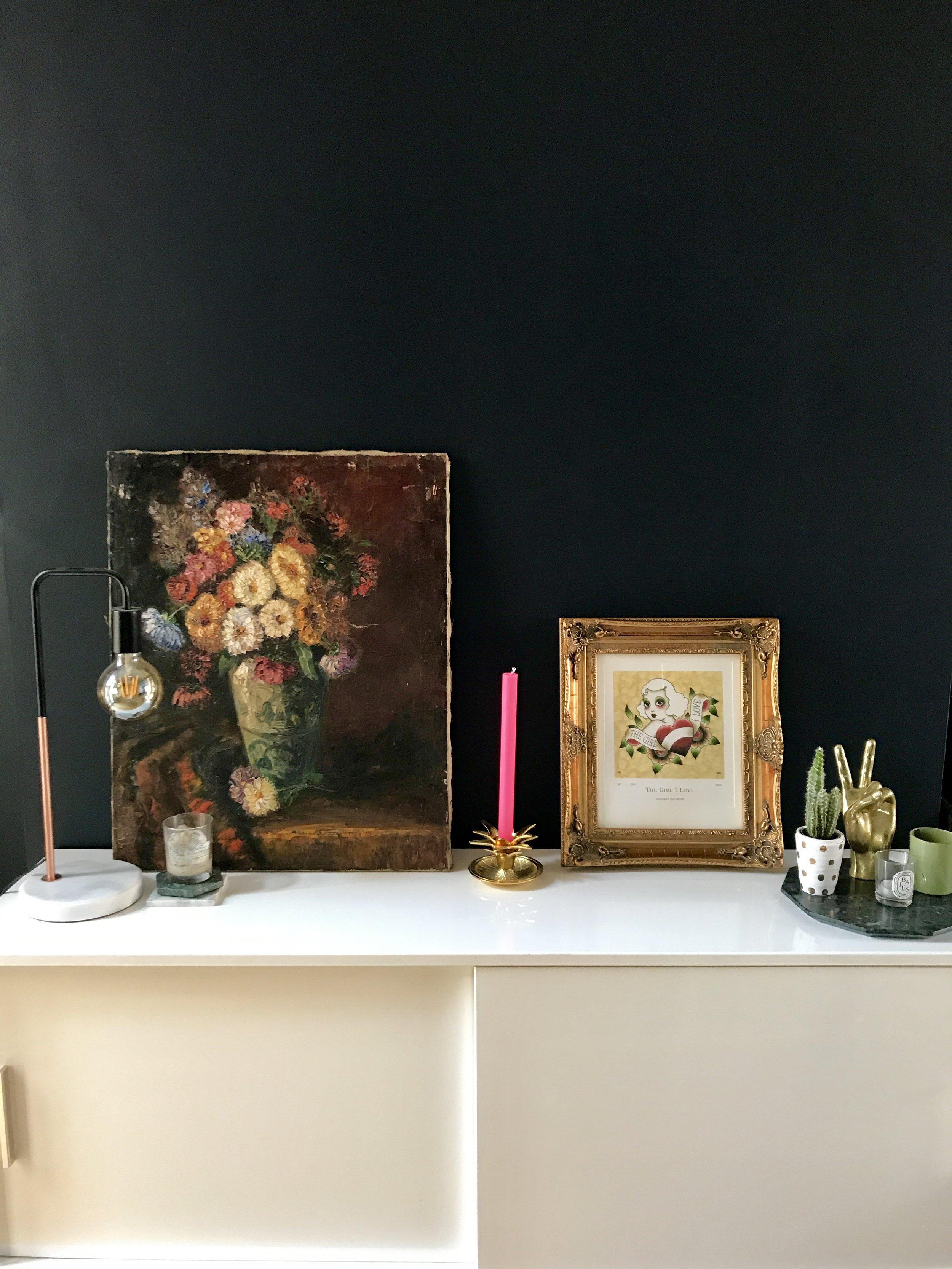 The oil painting was a Kempton Market find and the tattoo flash is by Angelique Houtkamp from Nelly Duff, table lamp from Aldi, candlestick from Maisons Du Monde and peace sign hand, Rockett St George.