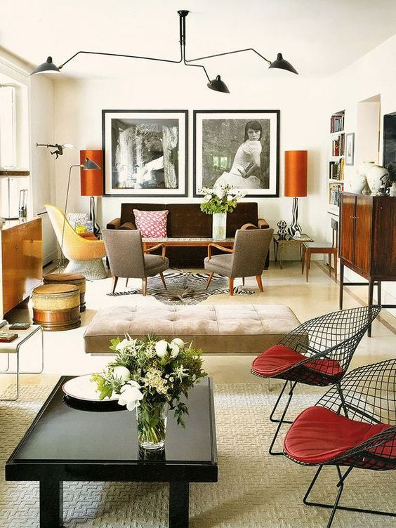 - I really should hate this room. I don't do 70's browns and oranges. But the classic Mouille pendant and the Harry Bertoia Diamond chairs drawing the eye down to the black and white photographs make the orange and the brown somehow totally acceptable to me.