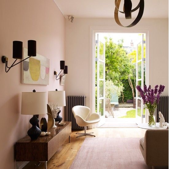 - I actually interviewed Myleene Klass in this house (it's not hers, it's a location house) and I spent the majority of the time pondering why it was that a blush pink room didn't feel overly girly (this was way before millennial pink was a thing). I worked it out in the end and went back to giving Myleene my undivided attention. Of course it was the black wall sconces, table lamps and pendant light.Image via Mel Yates for Living Etc