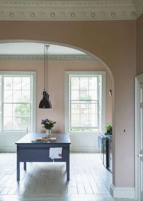Walls painted in Farrow and Ball's Dead Salmon - Image via Solid Wood Kitchens