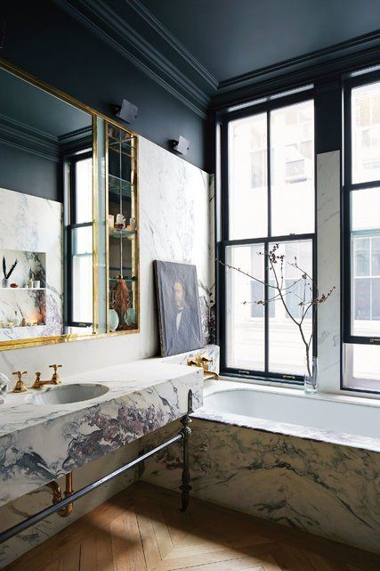 Jenna Lyons' marble, brass and black bathroom via  T Magazine