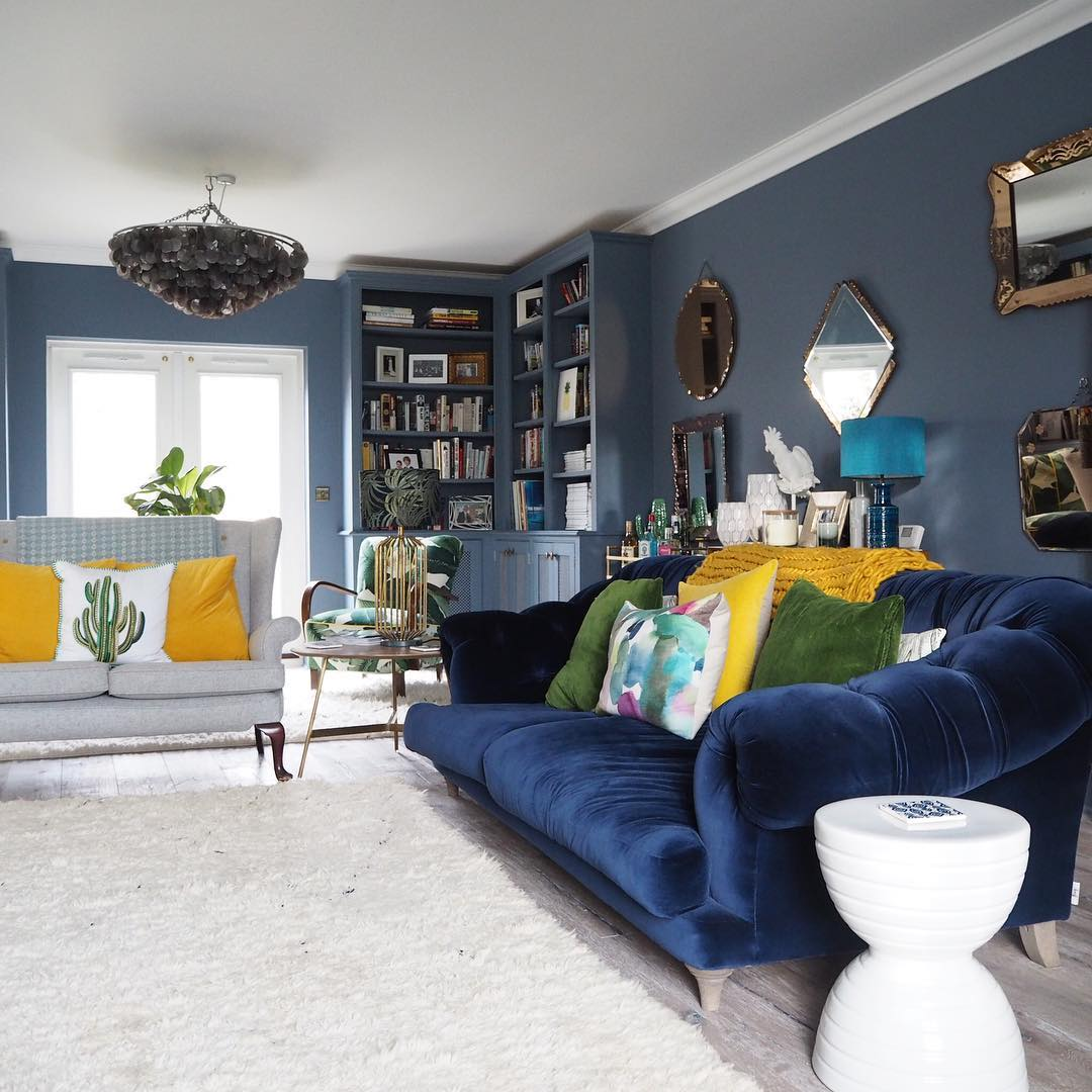 Erica's collection of Venetian glass mirrors have pride of place on her living room wall