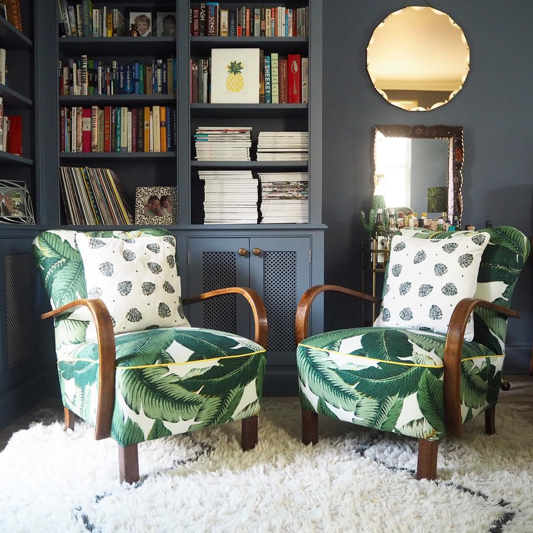Mid-Century cocktail chairs which were recovered in banana leaf palm fabric
