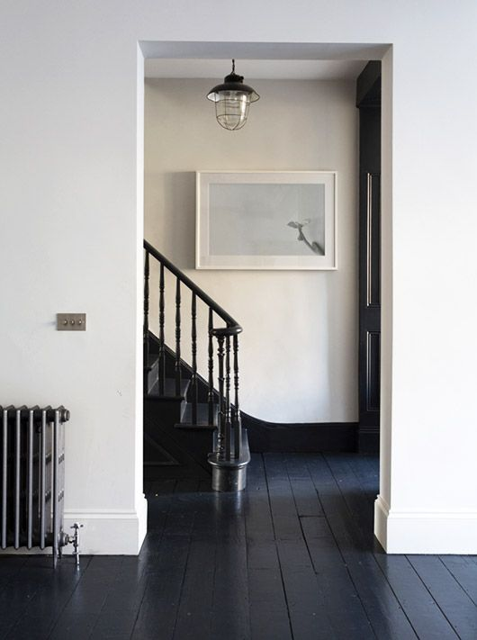 Black staircase and light walls - Image via JJ Locations