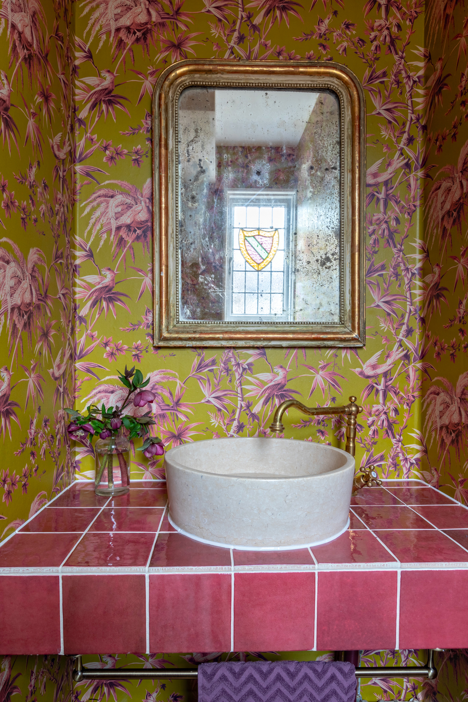 Bold House of Hackney wallpaper covers the downstairs loo. Image credit - Anna Yanovski
