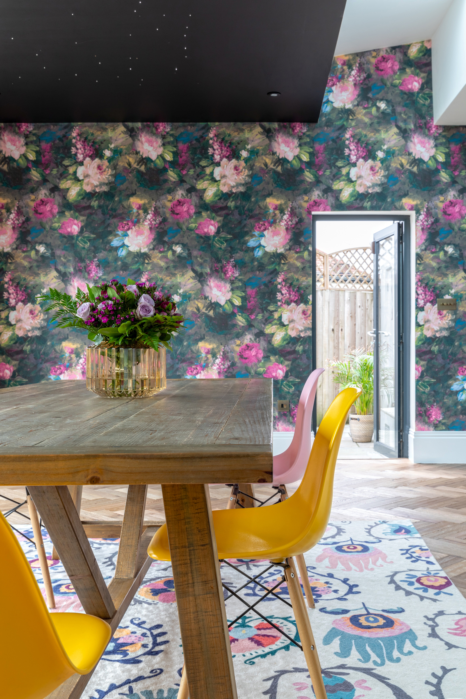 Woodchip & Magnolia's floral wallpaper transformed the previously sterile white kitchen. Image credit - Anna Yanovski