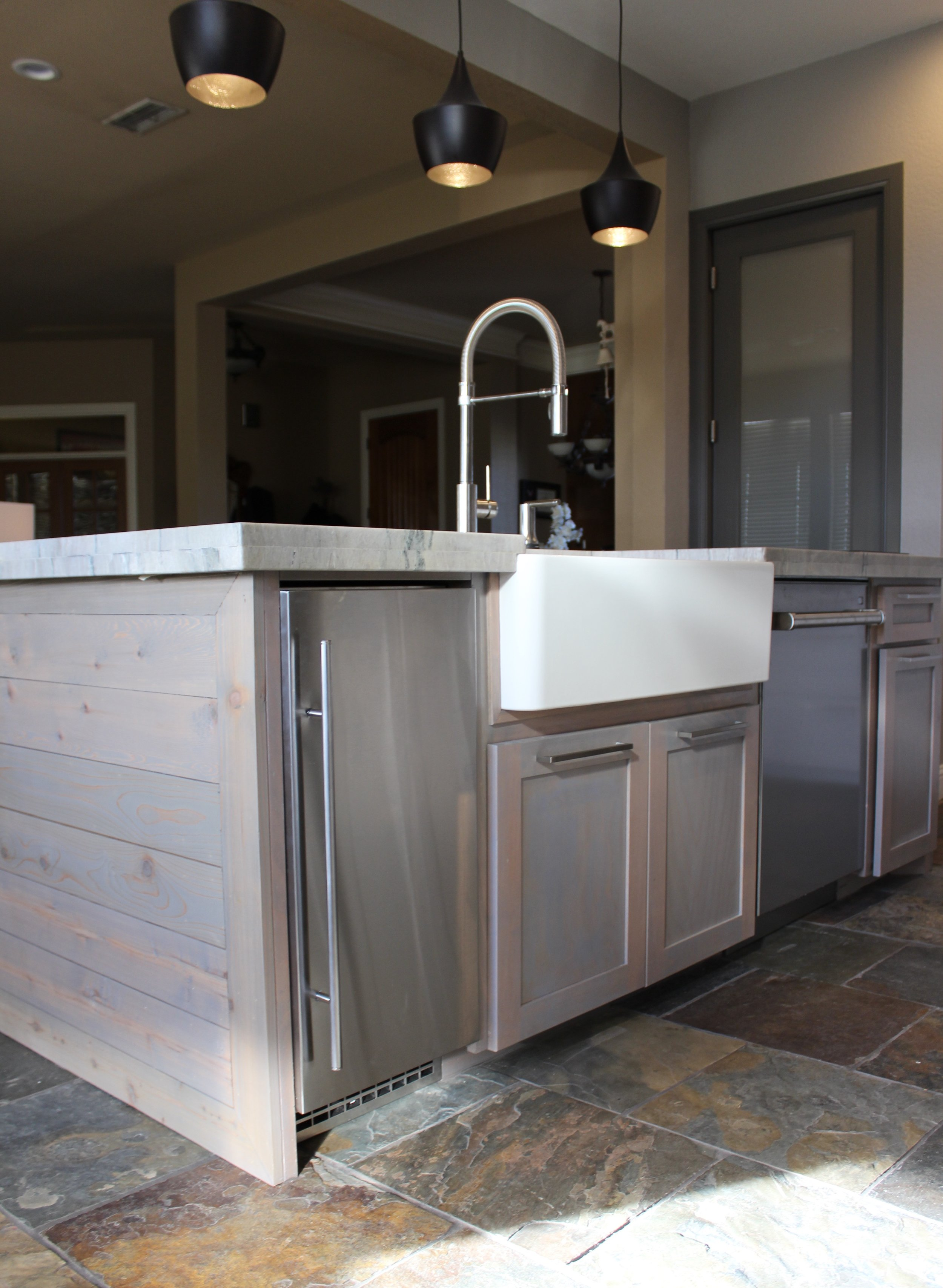 After: We opted for an expansive 5'x8' island complete with a fireclay farm sink, sonic ice maker, dishwasher, and a hibachi grill.
