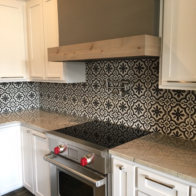 After: Expanded counter space, Wolf appliances, moroccan backsplash tile