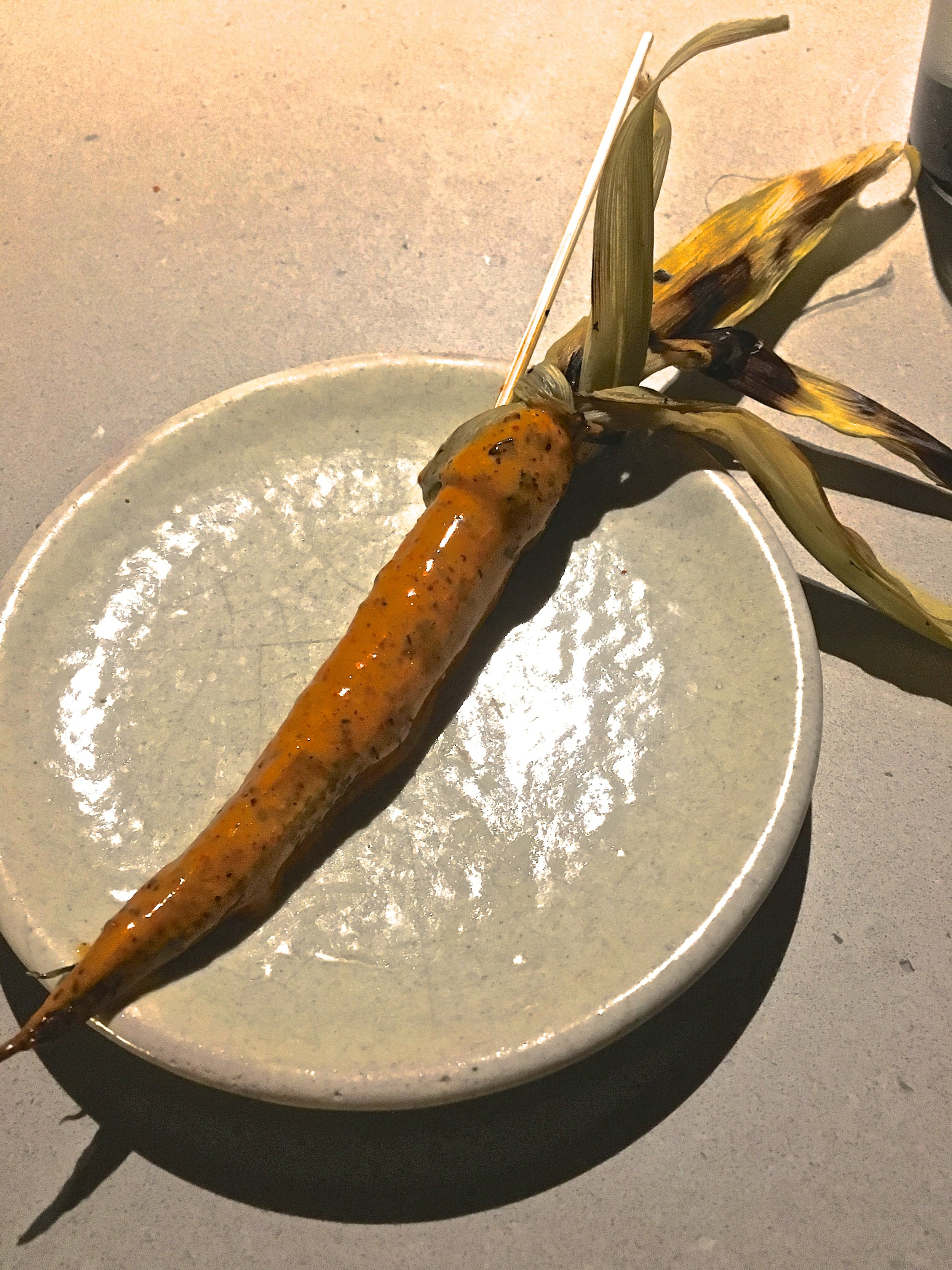 Elote dipped in a sauce made of ground ants. Yes, you read that correctly.
