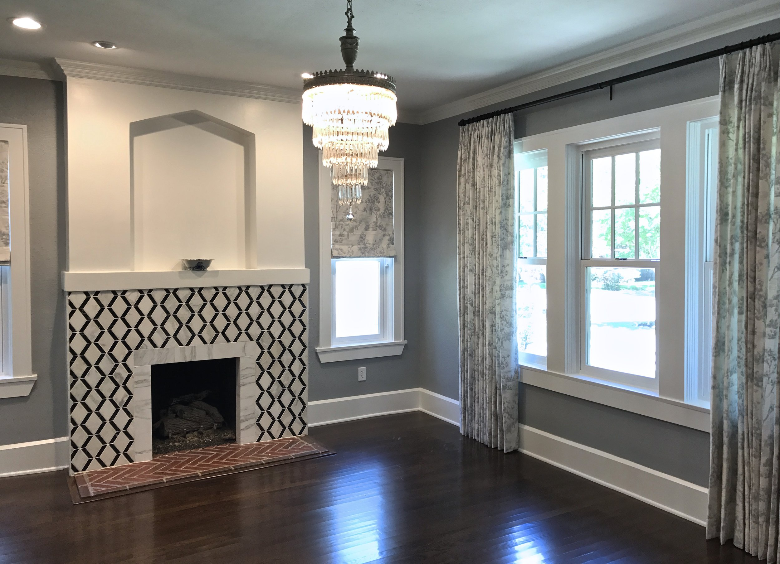New energy efficient windows modeled after historic craftsman windows of the time period.