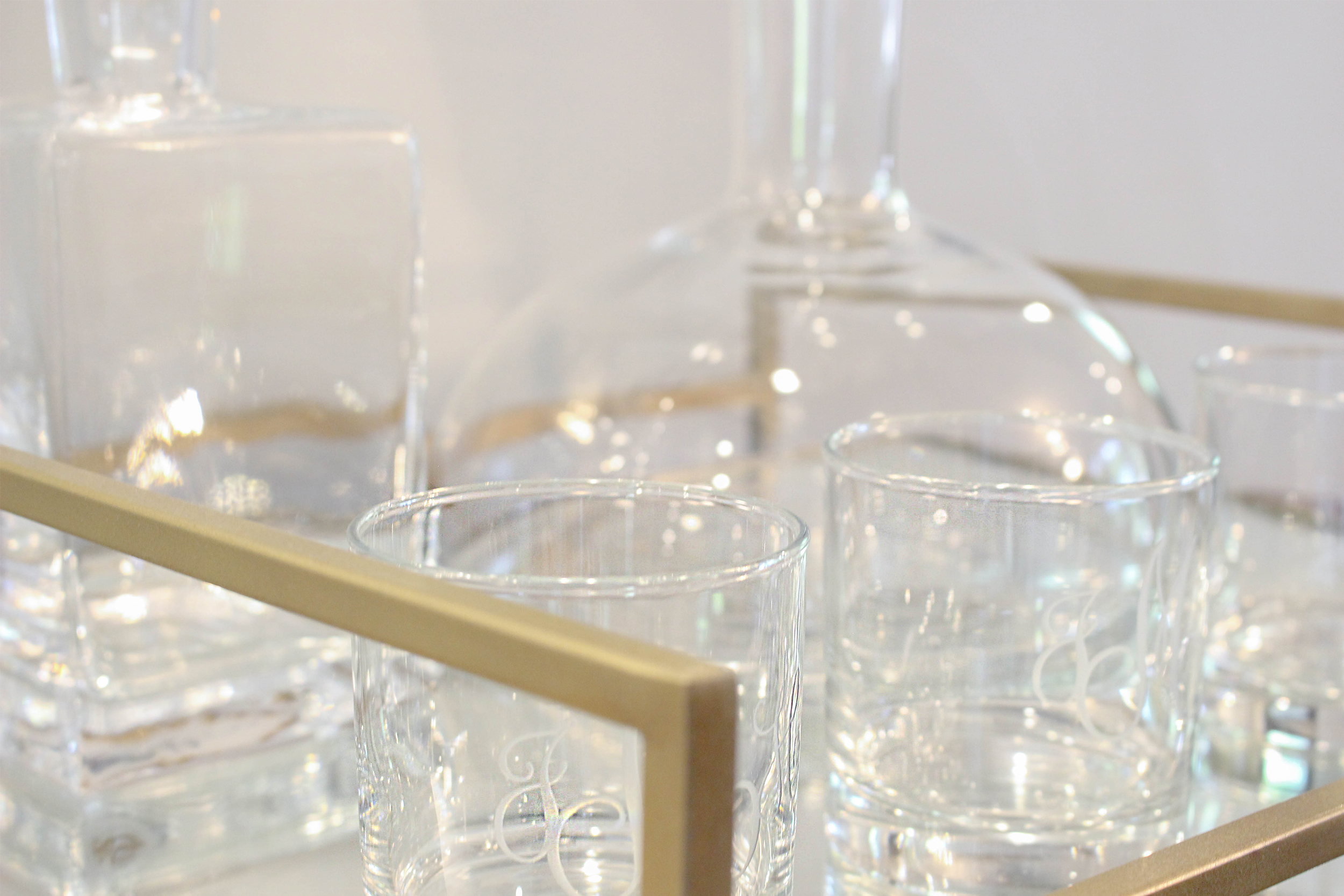 Brass bar tray detail. We used the client's own decanters and monogrammed highball glasses.