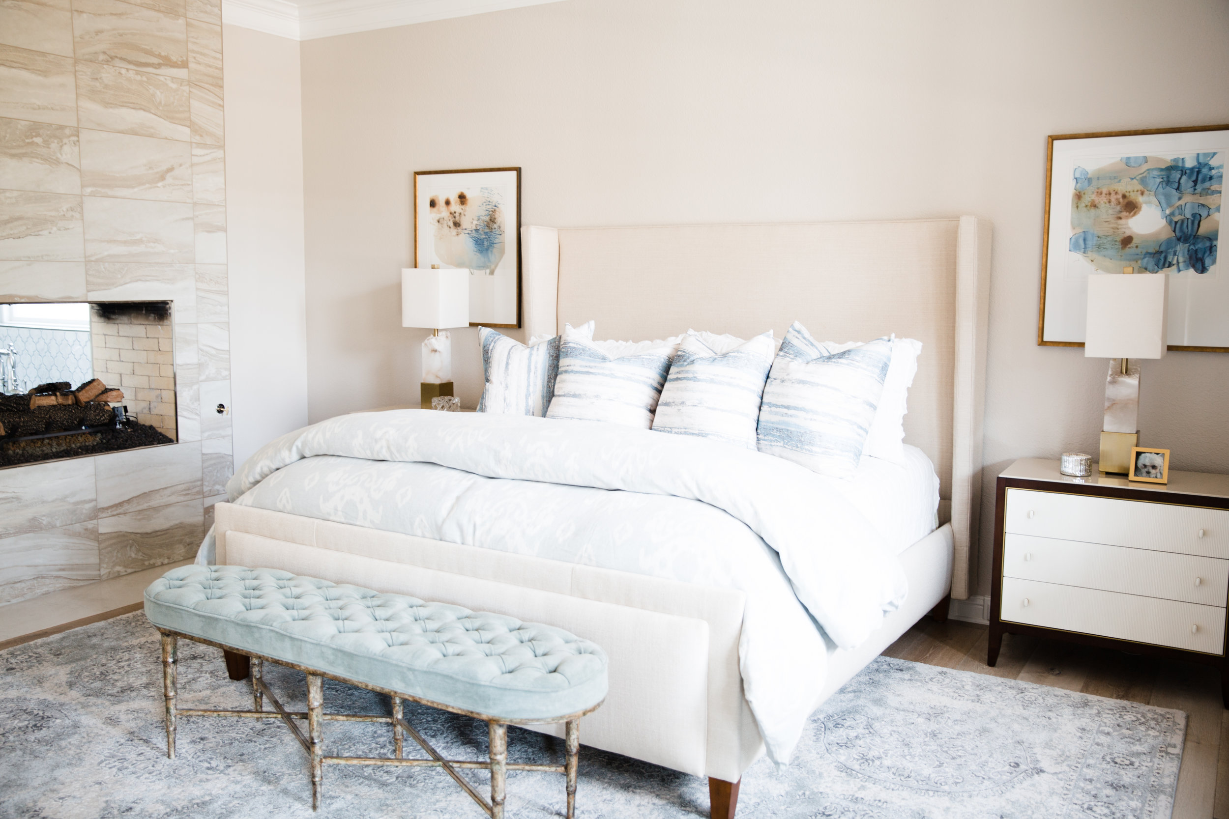 The master bedroom with soft and sumptuous bedding and a tall headboard.