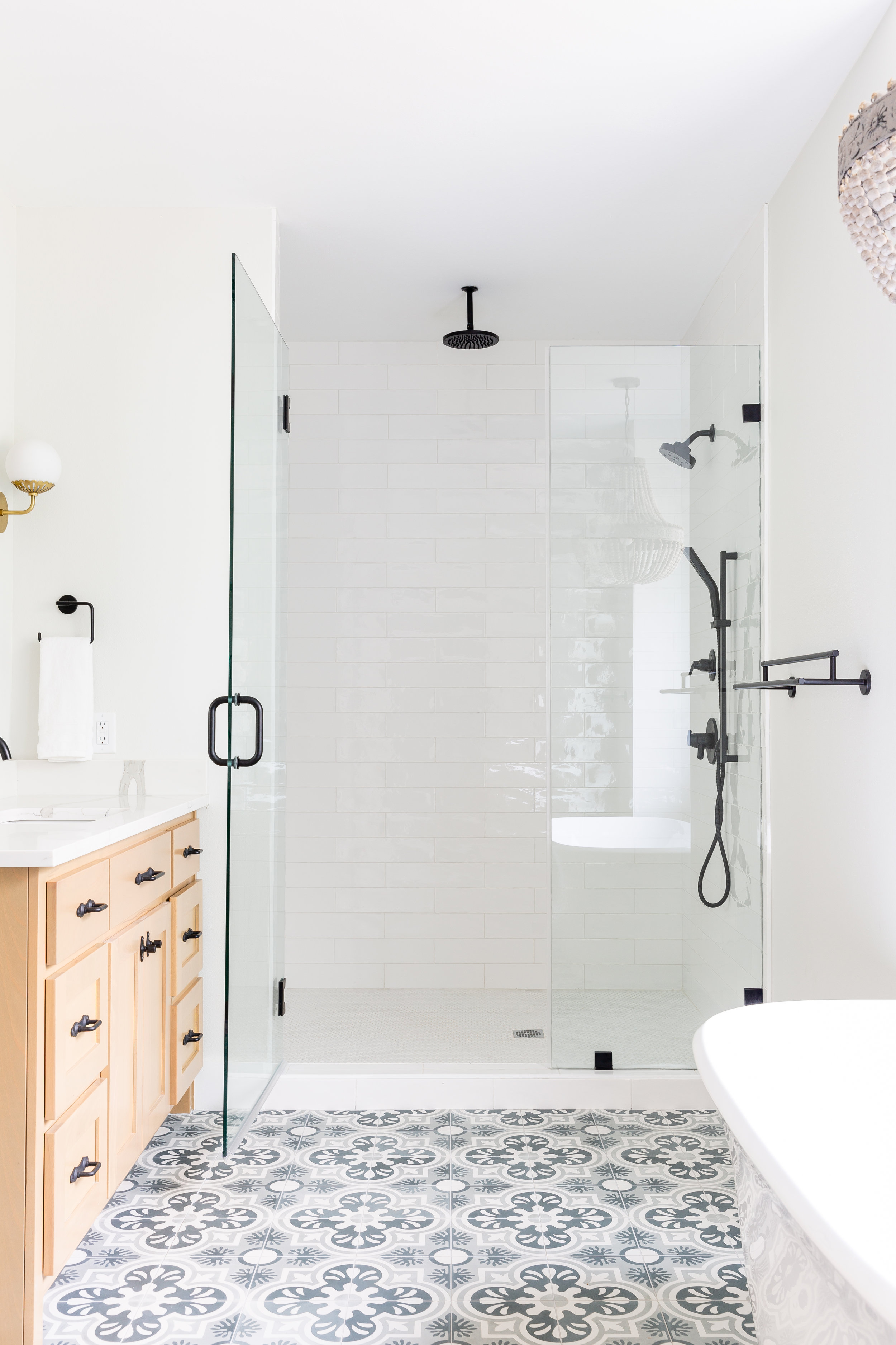 We wanted the master bathroom to be a private oasis with a blend unique & natural elements. We went for simple surroundings with one bold feature. This encaustic tile by  Villa Lagoon  provides a fresh take on an old fashioned pattern. Perfect for Sarah's modern farmhouse concept!