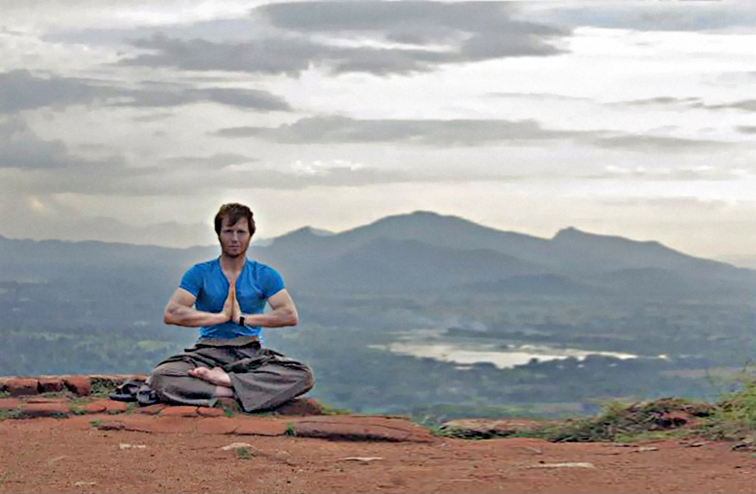 Niel Willcott lohan yoga on top of Sigiriya the lion mountain.jpg