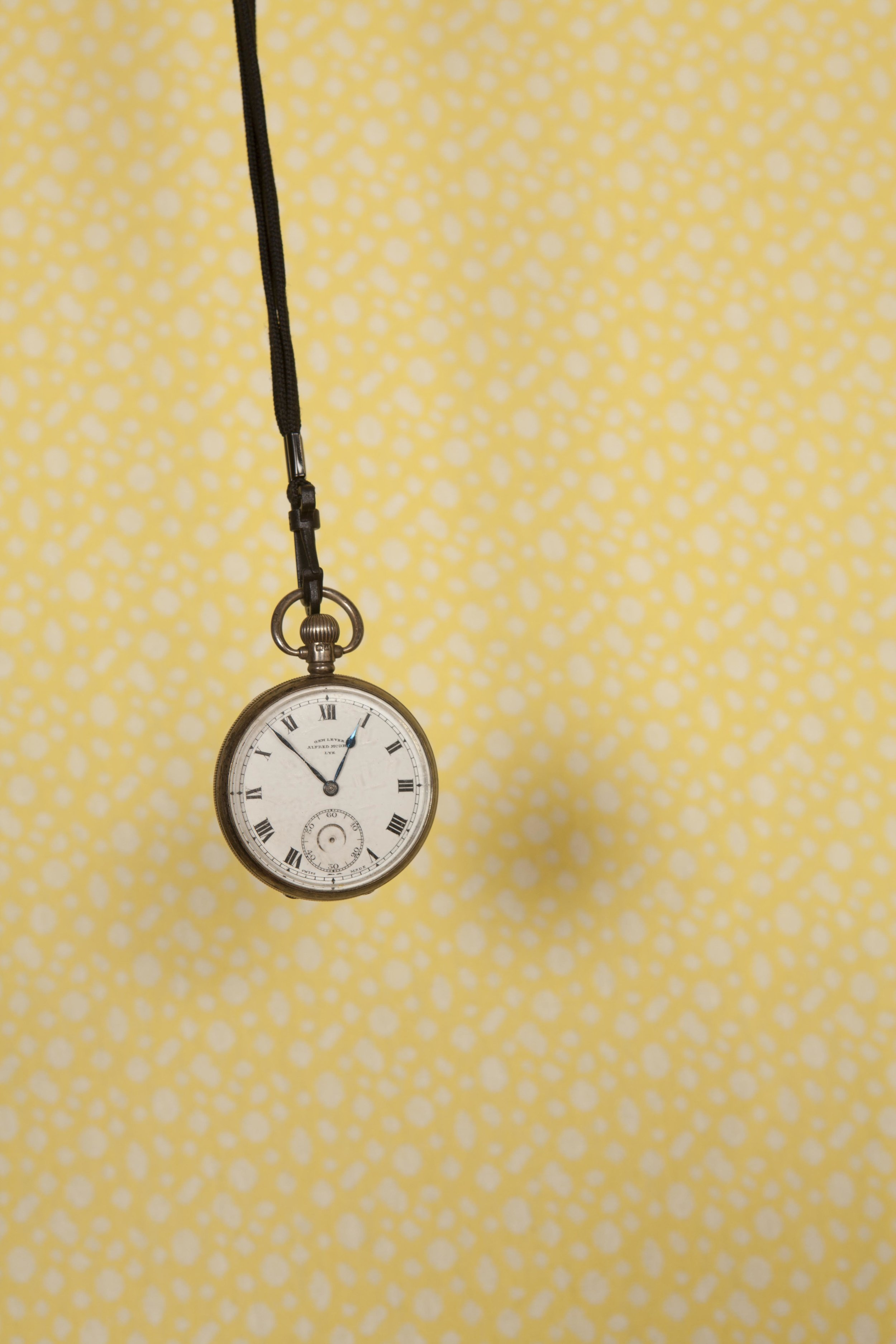 """I featured my dads pocket watch because except for at christmas my family all live too far away to photograph. I have fond memories associated with his watch.  In the nineteen forties wrist watches were not so common. My dad was a foreman in an engineering factory producing essential goods for the war. He wore a pocket watch. Women were draughted in replacing men away fighting. Unused to the industrial environment dad and the girls didn't see eye to eye all the time. Occasionally they would sing """"you are my sunshine"""" to him.  Words and photograph by Peter Holmes."""
