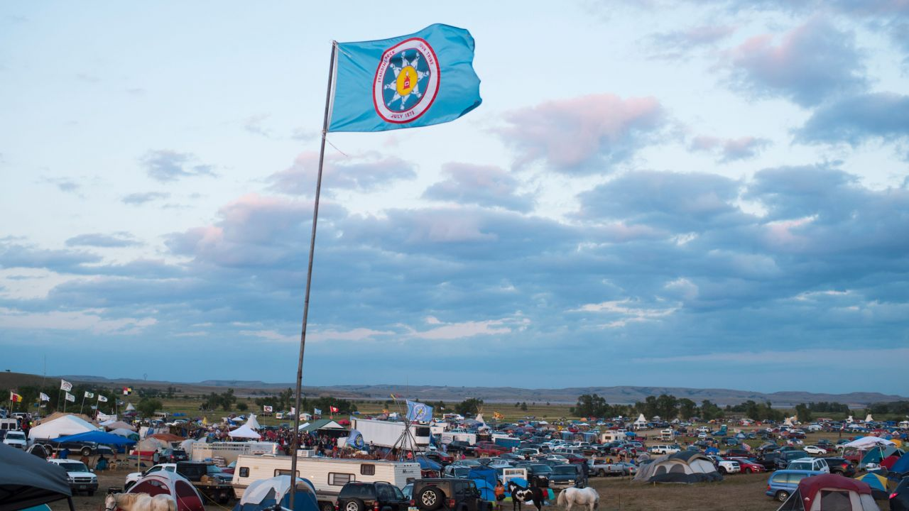 A camp in Cannonball, North Dakota, where the Standing Rock community is joined by supporters in defending their treaty rights agains the Dakota Access Pipeline as the reservation flag flies overhead.