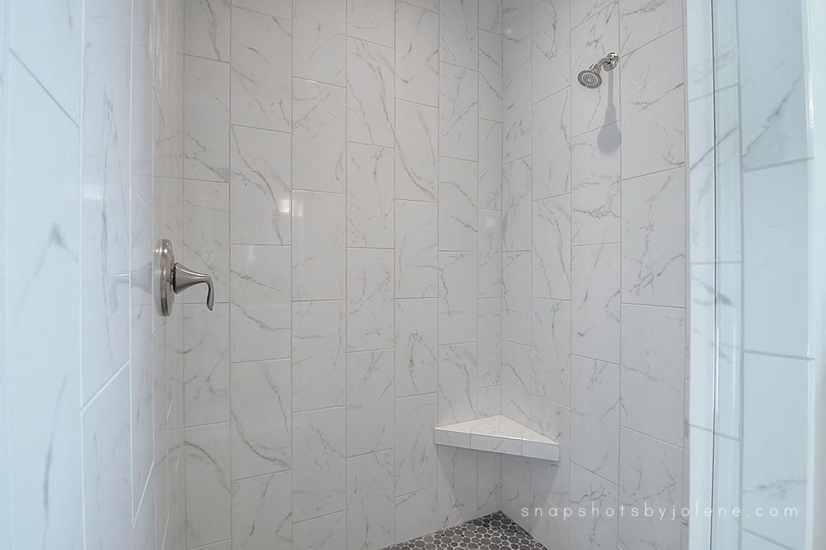 boise real estate white marble bathroom