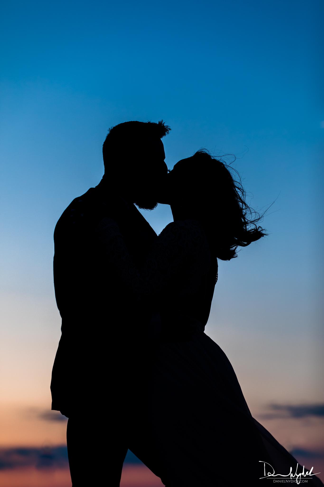 engagement silhouette sunset