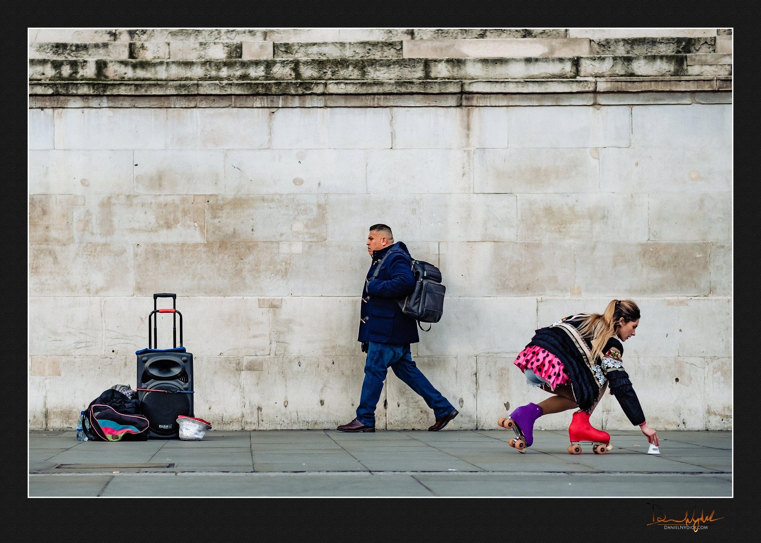 street scenes, people, candid, rollersakte, man walking, picking