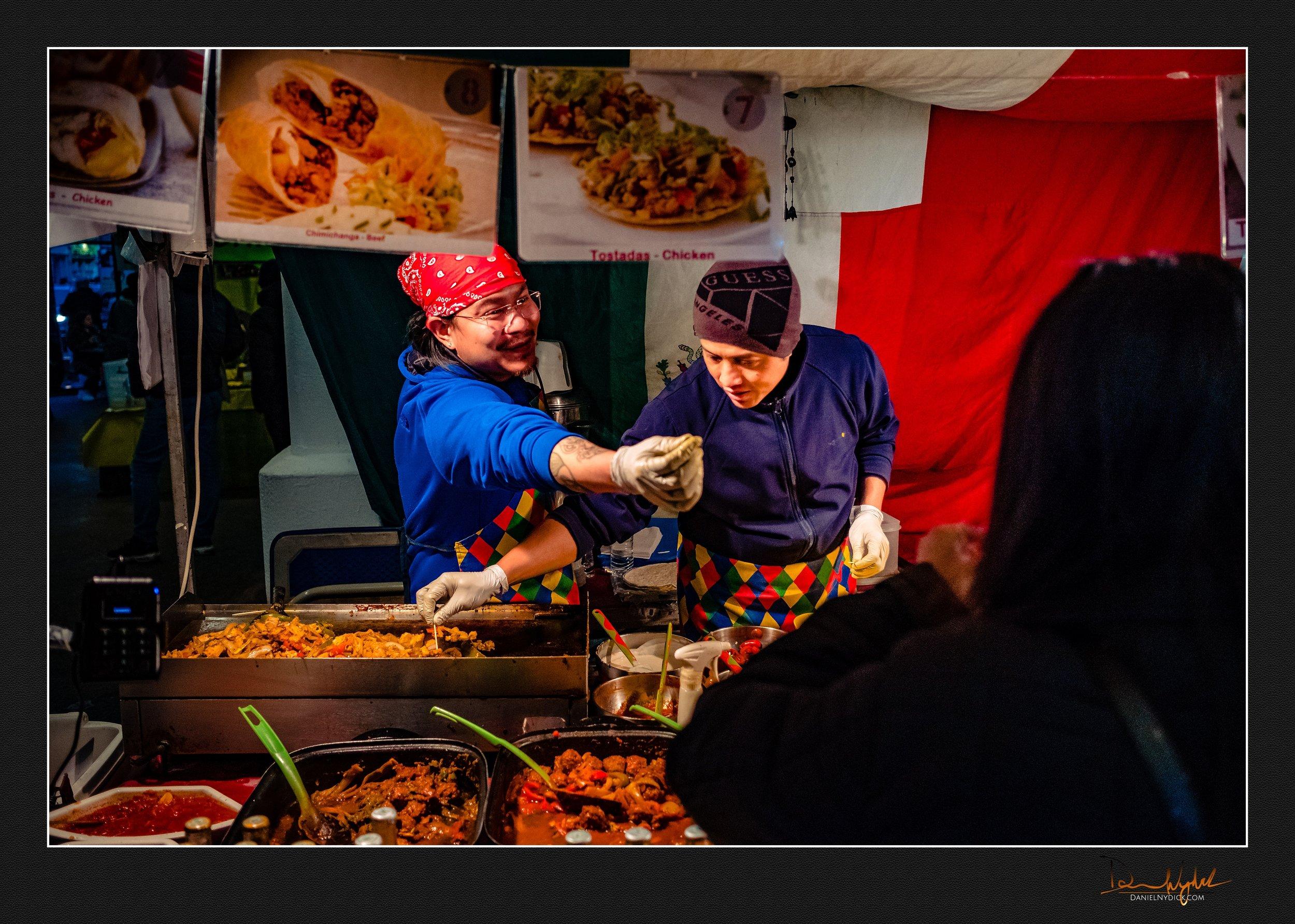 bricklnae market, food vendor handing food and smiling