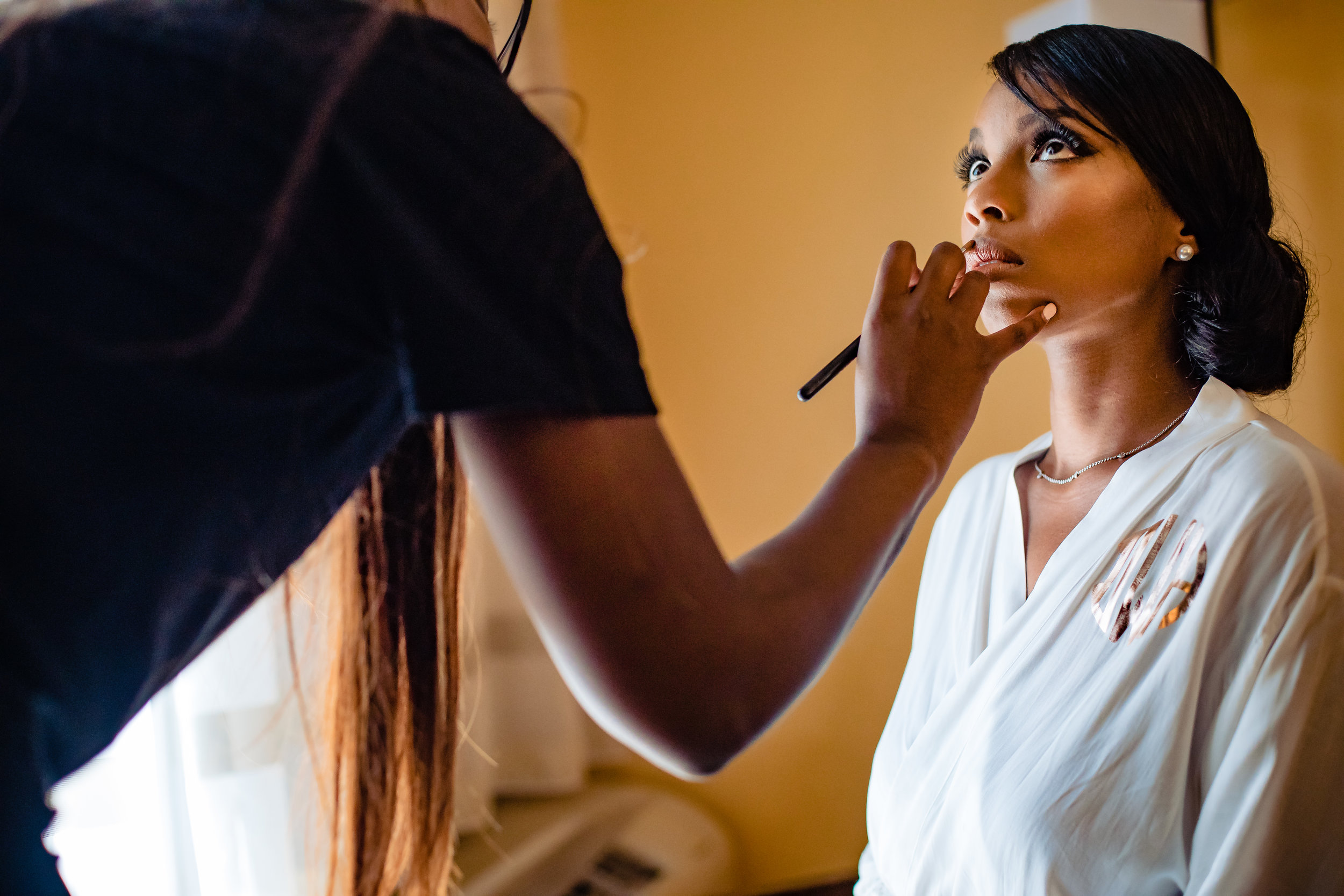 bride getting her make up applied