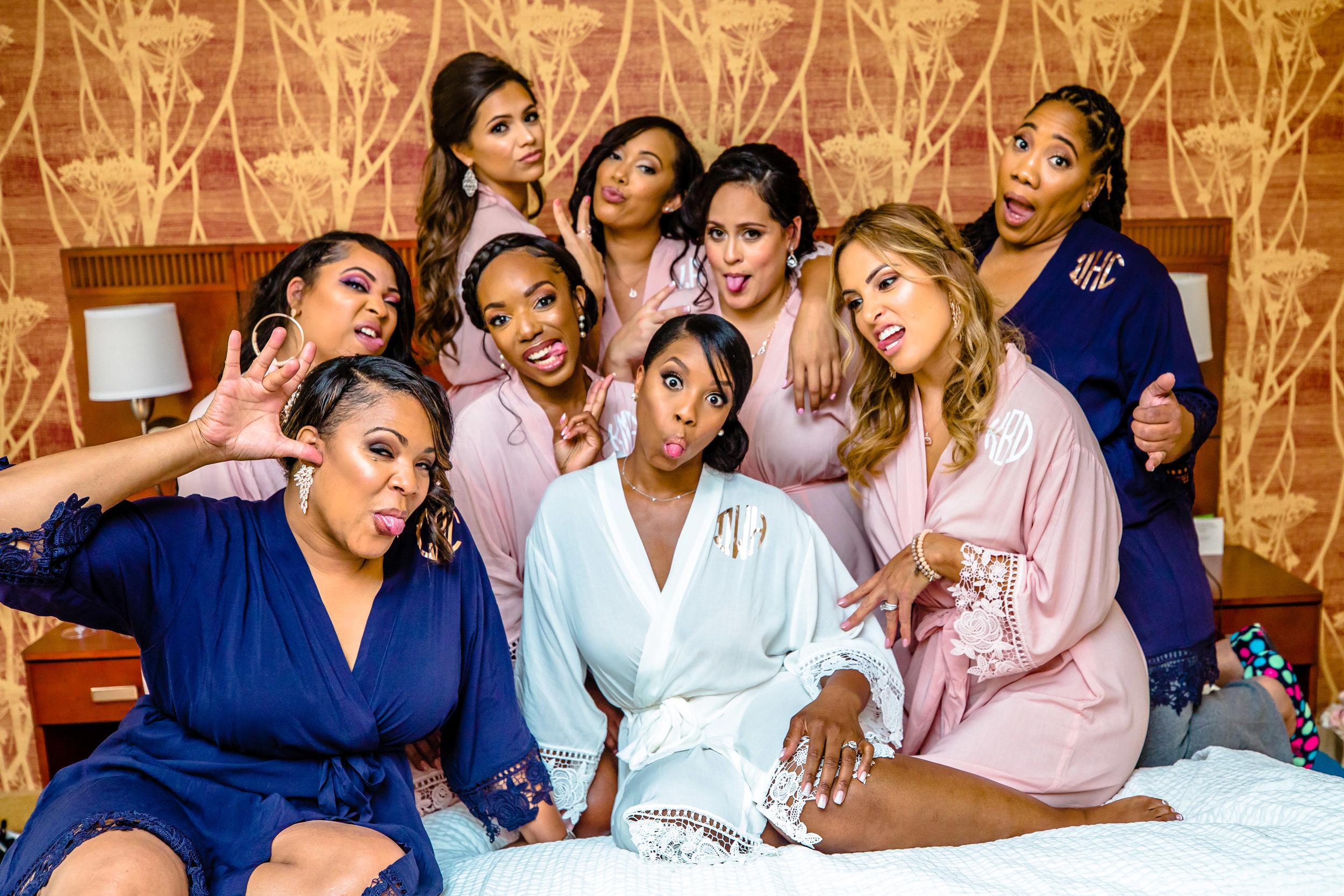bridesmaids in robes having fun