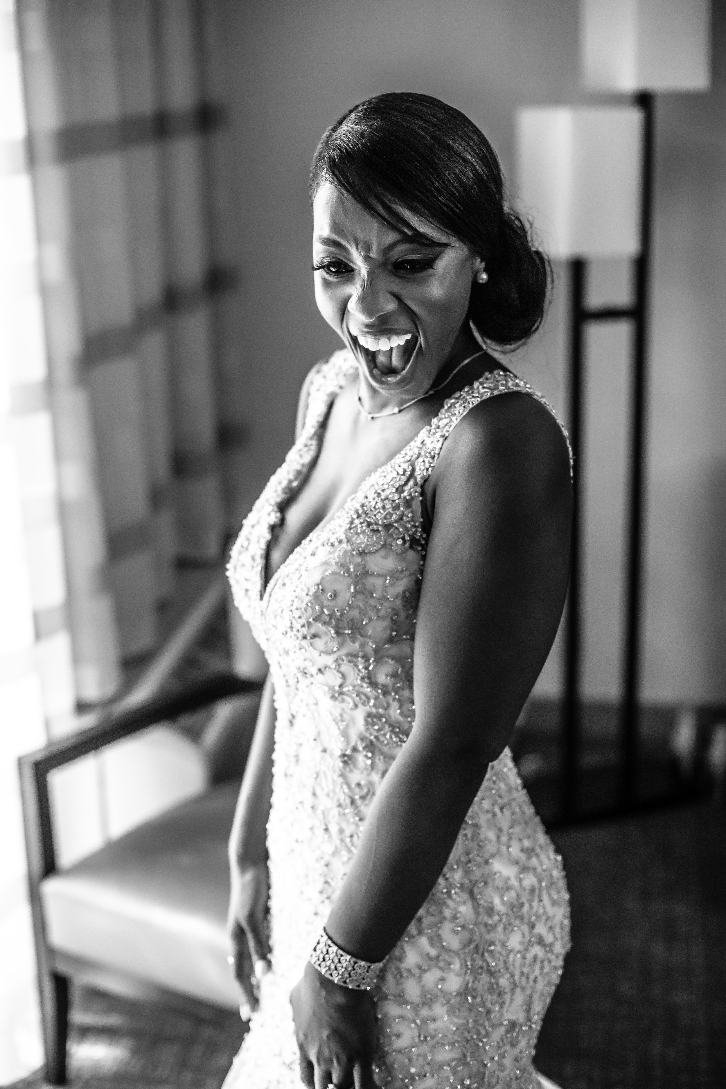 excited bride seeing her self in the mirror