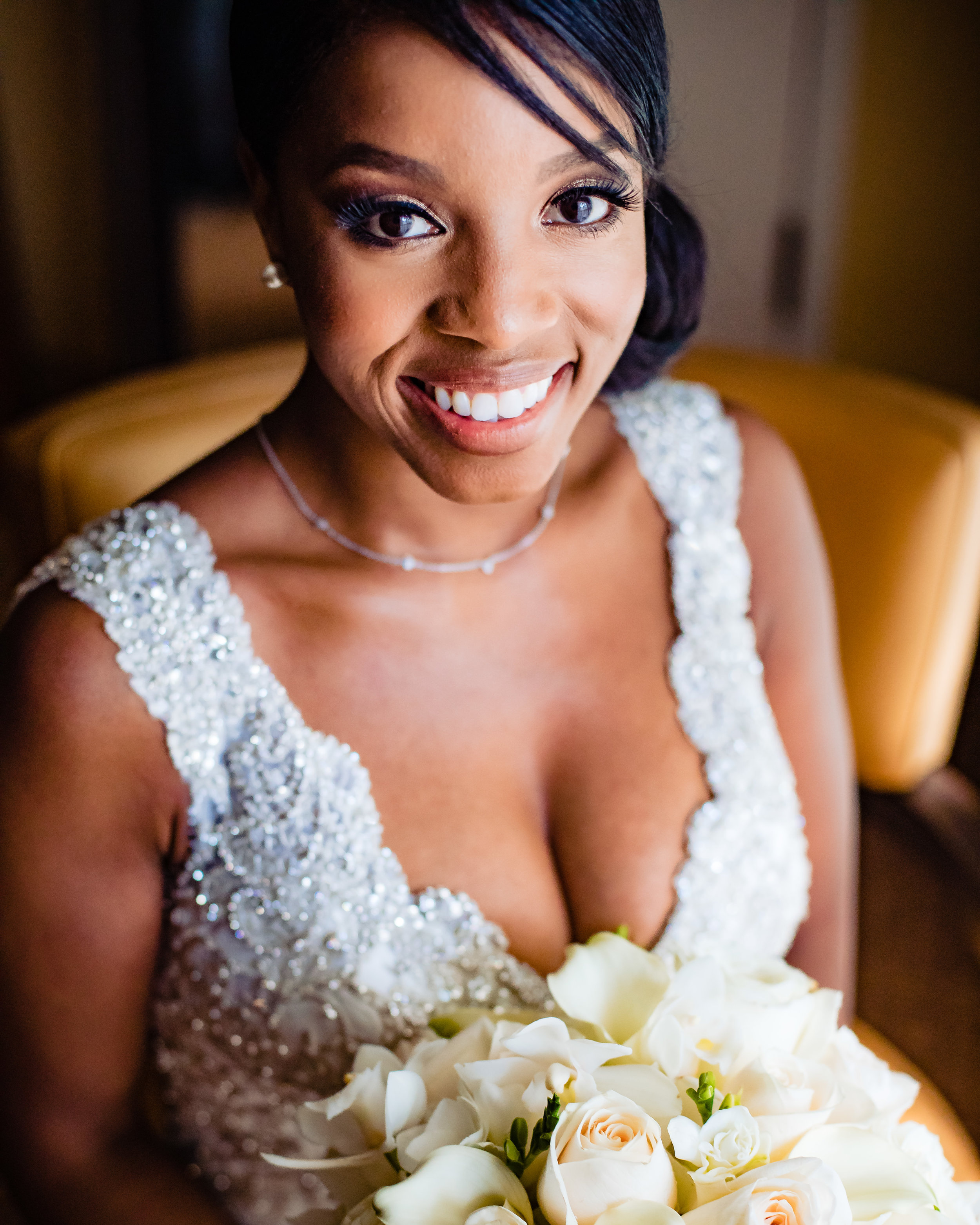 bridal portrait of a bride and her smile and her bouquet