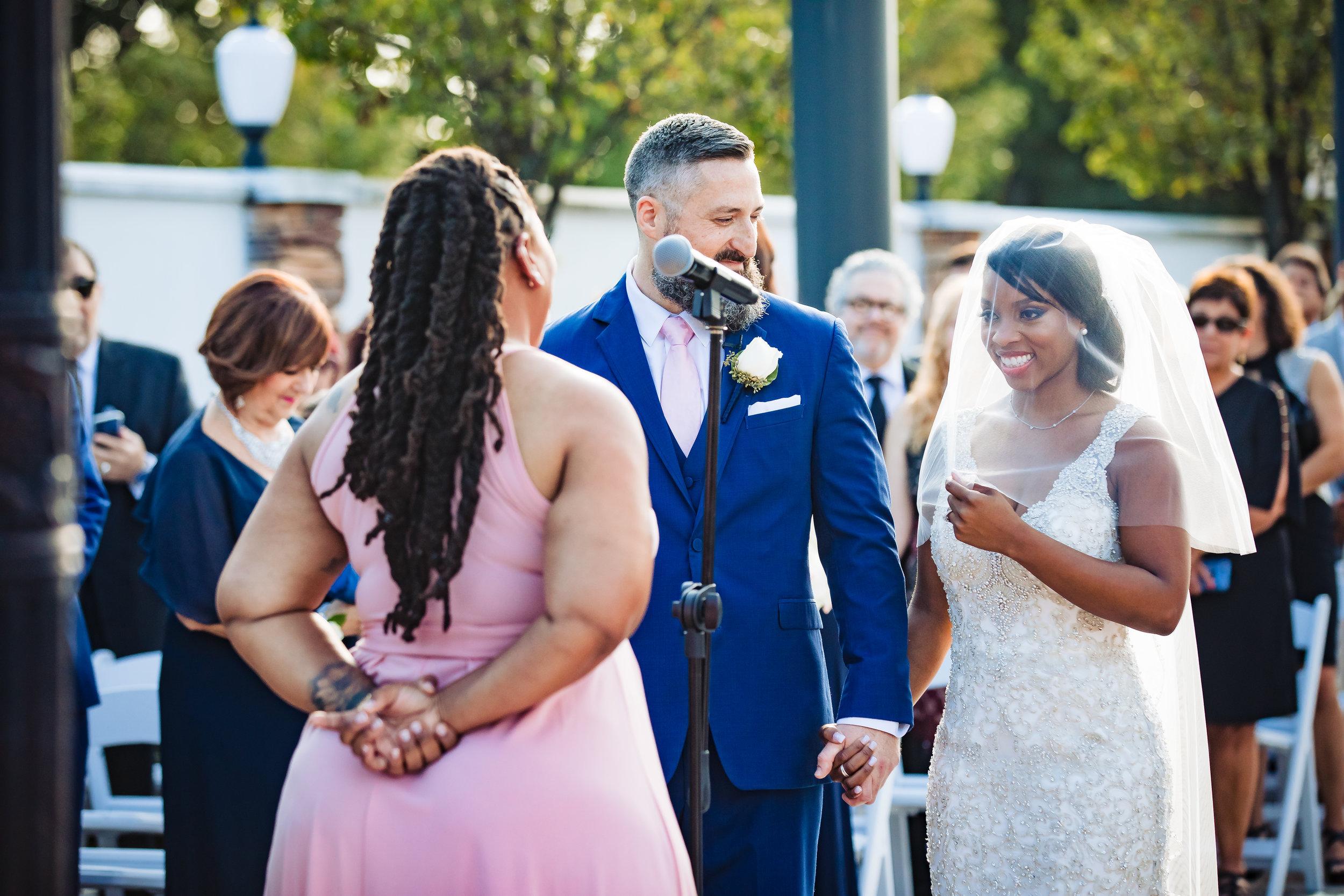 bride smiling at her wedding