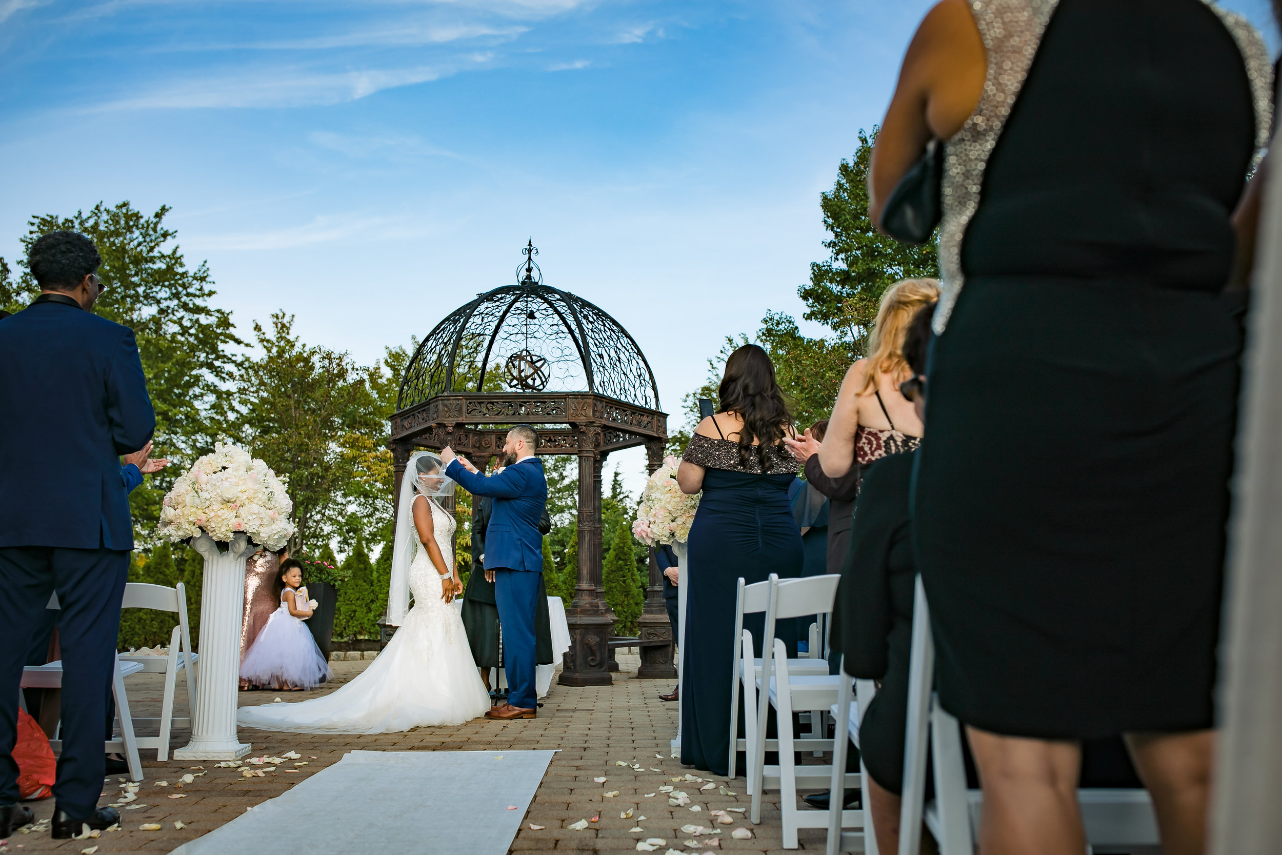 groom lifts the veil